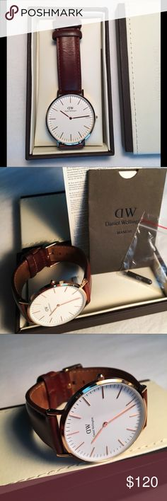 St. Mawes Stainless Steel Rose Gold Brown Band Rose gold-tone stainless steel case with a brown leather strap. Fixed rose gold-tone bezel. Eggshell white dial with rose gold-tone hands and index hour markers. Minute markers around the outer rim. Daniel Wellington Accessories Watches