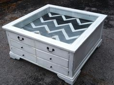 Distressed grey and white glass top display coffee table. I love the storage and display top! My best friend has one similar to this and I've loved it since she got it.