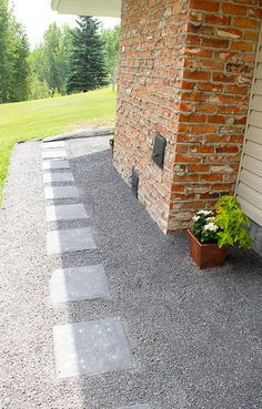 Build your own outdoor walkway, with affordable materials, and easy landscaping with limestone and sidewalk blocks. Low maintenance, and a low cost DIY!