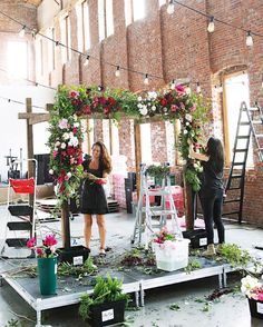 Wedding flowers on a salvaged wood arbor/chuppah (built custom by Tin Can Studios) to match the wooden beams at the venue. Peonies, garden roses, tea roses, ranunculus, etc at Pioneer Works in Brooklyn.