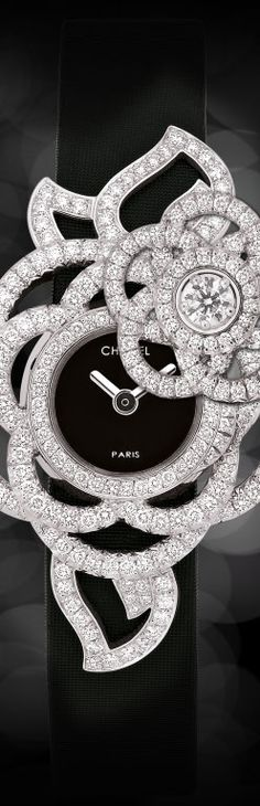 CHANEL JEWELRY WATCH.IN 18K WHITE GOLD AND DIAMONDS.  Is this a little too decorative?  Not sure but it looks decent enough to us.