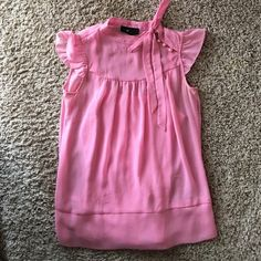 Pretty in pink blouse Very cute blouse. Sheer top with and attached tank top. There is a faint mark on the front please see pictures BCX Tops Blouses