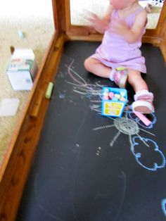 Creative small-space solution for kids - Chalkboard on the underside of a coffee table.