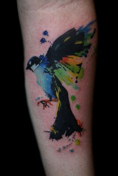 colorful watercolor bird tattoo