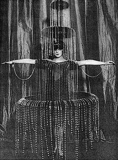 """Poiret costume for the Marchesa Casati.The Marchesa Casati, a Venetian noblewoman who died in 1957, famously said, """"I want to be a living work of art."""" She wore elaborate gowns by Paul Poiret and Léon Bakst with Lalique jewelry and live snakes, and was sometimes accompanied by cheetahs on diamond leashes."""