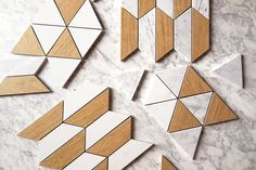 Geometric Lifestyle | A combination of timber look tiles, white porcelain and real Carrara C marble.