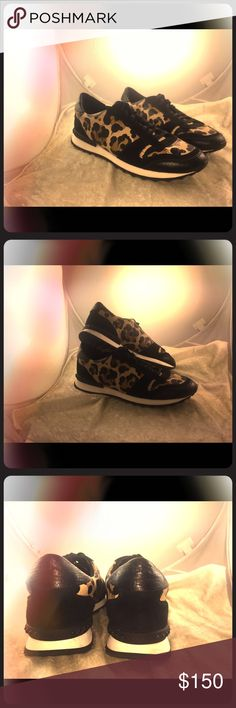 Coach sneaker size10tried on once in new condition Coach sneaker black brown tan and white colorway design print camo Coach Shoes Sneakers