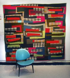 Wool plaid quilt by Sherri Lynn Wood, keep this in mind as inspiration for recycled wool shirts.