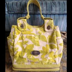 Petunia Pickle Bottom Cake Society Satchel bag Petunia Pickle bottom cake brand society satchel in lemon chiffon cake. This is a diaper bag that can also be used as a purse after baby. Beautiful like new condition. Comes with changing pad and brand new cake wipes case. Bag only used a few times. Excellent very clean condition. No pulls, rips, or stains. Make me an offer! Petunia pickle bottom Bags Satchels