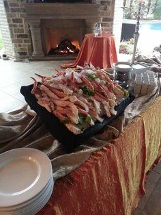 A Raw Bar display of king crab legs #CNCatering #DallasCatering #WeddingCatering #TexasCatering #DallasFood #WeddingFood #TexasFood #DallasWeddigns #TexasWeddings #WeddingEntree #RawBar #Oysters