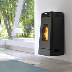 Browse our Pellet stoves catalogue and choose among our models the one that fits your needs. Pellet Stove, Sweet Home, Home Appliances, Luxury, Wood, Furniture, Fireplaces, Design, Air Fan