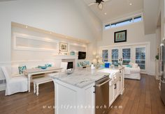 Vaulted High Ceiling in Living Room with an open concept kitchen.