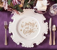 """FUN HOLIDAY TIP: Put a fun vinyl design on your holiday plate charger! As your guests remove each layer of the place setting they will be greeted with another little design surprise! """"Be Merry and Bright"""" saying designed by Cecilia Harris of Wordsworth®."""