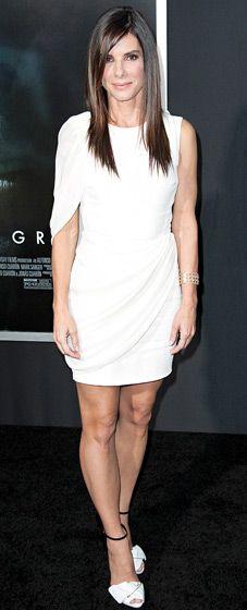 Sandra Bullock rocked a white one-sleeved mini dress by Giambattista Valli, Giuseppe Zanotti shoes, and Martin Katz jewelry at the Oct. 1 premiere of Gravity in NYC.