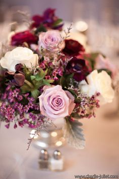 Vintage plum wedding, with lavendar and white roses, deep purple anemones  and purple wax flowers