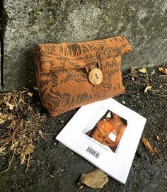 A personal favorite from my Etsy shop https://www.etsy.com/listing/480478279/out-in-the-wild-clutch-iii