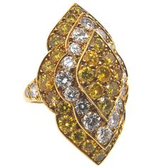 VAN CLEEF & ARPELS superb coloured diamond ring.An incredible yellow and white diamond ring, the curving marquise shaped face of the ring set with lines of coloured diamonds, totalling 33 vivid yellow diamonds and 24 white diamonds with a total weight of approximately 8.35 carats.Circa 1970s