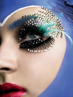 Feathers, glitter, sequence all kinds of things all at once. Great fantasy makeup inspiration.