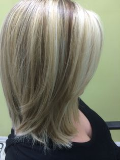 Three shades of blonde foils shoulder length Bob Cut
