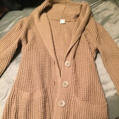 Long tan cardigan from Pacsun Long button down cardigan. Knitted material. Lightly worn, like new condition! Kirra Sweaters Cardigans
