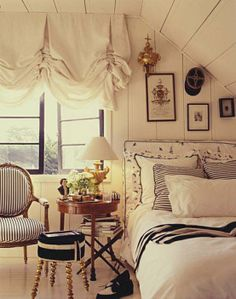 White-washed wood walls and great slouchy roman shade