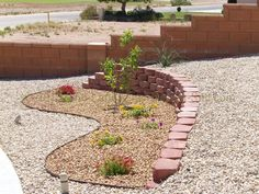 Desert Southwest landscaping on a small hillside circular driveway using retaining walls and Xeriscaping principles and