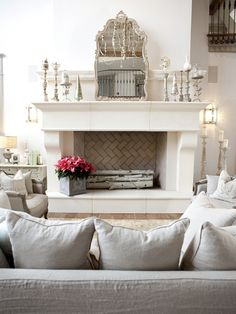 I love the mirror over the fireplace...Although I wouldn't angle it like that...