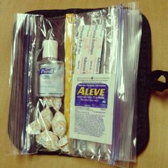 Mini emergency kit made out of a pot holder and ziploc baggies sewn together!
