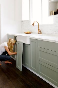 For those who want the look of custom cabinetry without the cost, Semihandmade doors are the answer. The company produces doors, panels and drawer faces designed specifically to fit IKEA cabinets, and, as you can see by these pretty sage cabinets, they look quite luxurious! | 16 Astoundingly Chic IKEA Hacks via @MyDomaine