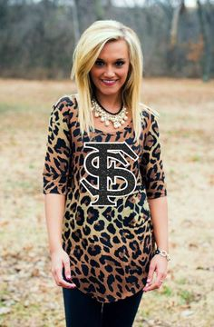 Go wild with this Game Day Couture Leopard Print FSU Half Sleeve Tee! This longer length jersey tee isperfect to pair with jeans or leggings! Embellishment features black glitter and white matte screen print.  Color: Leopard
