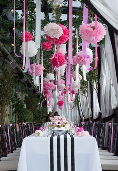 pink and white pom poms and ribbons with black and white stripe table linens for a bridal shower