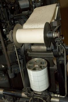 Detail of a Monotype Typesetting Machine Model C, Punch Tape and Cylinder for Controlling Word Spacing