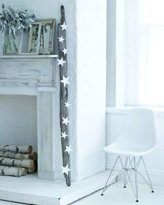 "Driftwood Mantle - ""This is simply a large piece of driftwood with white paper stars glued to it. I have to say it's really festive looking, right?"""