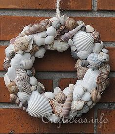 - straw wreath  - seashells of choice in different sizes  - hot glue gun  - rope for hanging