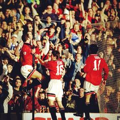 Ecstasy surrounding Eric Cantona's goal against Liverpool in 1995 was evident as he joyously leapt onto the net's stanchion in front of celebrating United fans. #classicmufc