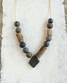 pit fired ceramic necklace wooden beads and pebble artisan