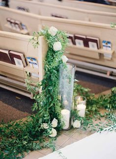 White roses, greens and candles lined the church pews