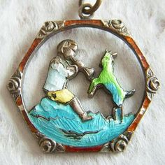 Early 1900's Czechoslovakian enamel pendant charm of a boy and his goat
