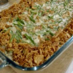 Green Bean Casserole Ingredients 1/3 stick butter & 1/2 cup diced onions & 1/2 cup sliced fresh mushrooms & 2 (10 3/4-ounce) cans French cut green beans, drained & 1 (10 3/4-ounce) can cream of mushroom soup & 1 (2.8-ounce) can French-fried onion rings & 1/4 block of Velveeta, cubed & Salt, pepper, garlic powder to taste & 1 cup grated Cheddar & Directions Preheat the oven to 350 degrees F.  Melt the butter in a large skillet. Saute the onions and mushrooms in the butter. Add the mushroom…