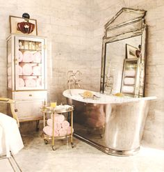 Silver Bath Up With White Inside Combined With White Wooden Storage With Glass Shelves Placed On The White Floor, Beautiful Bathrooms Pics To Renew Your Old Bathroom Design: Bathroom