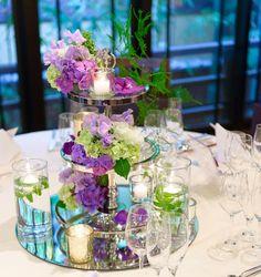 「装花はpurpleメインでお願いしました✨ 下にミラーをひいてキャンドルを沢山置いて、より明るく温かみのある演出をして頂きました ・ #wedding#2017春婚 #会場装花 #装花 パープル ラベンダー purple lavender
