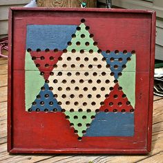 Although ours looked different, we had and played chinese checkers on a wooden board for hours and hours.