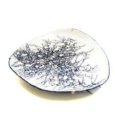 By Lydia Feast. Enamel, silver.
