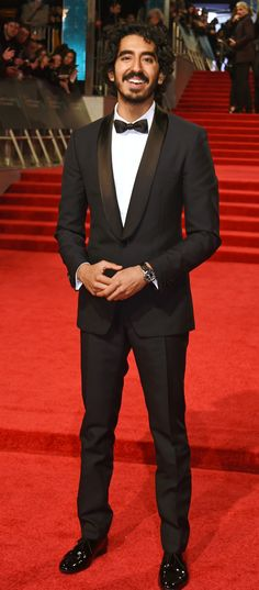Celebrating the BAFTAs in London, Best Actor in a Supporting Role Winner Dev Patel wears a Burberry custom made navy tuxedo Pretty Men, Beautiful Men, Beautiful People, Bafta Red Carpet, Dev Patel, Navy Tuxedos, Baby Daddy, Hollywood Celebrities, Attractive Men