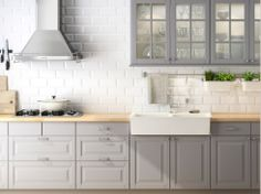 Grey cabinets, white walls, butcher block countertops