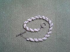 A spiral-stitch bracelet I made. Pretty!