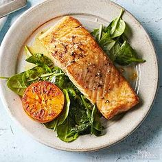 Don't stop at an orange salmon marinade -- serve these flaky fish fillets on a bed of spinach with a slightly-charred orange half on the side.