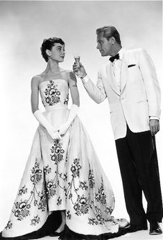 "Audrey Hepburn and William Holden publicity still for ""Sabrina"", 1954 (gown by Edith Head)"