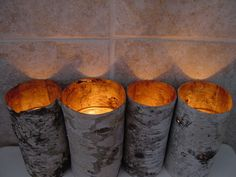 We love how Cynthia uses her birch tubes to hold glass votive candles. Because the bark is thin, light peeks through casting a lovely, warm glow. Glass Votive, Votive Candles, Birch Bark Crafts, How To Make Lanterns, Save On Crafts, Inspired Homes, Decoration, Just In Case, Candle Holders