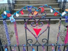 Local crocheter Margaret Kane yarn bombed her front gate to signpost people to the trail :) Margaret Kane, Yarn Bombing, Yarn Shop, Deco, Knitting Yarn, Gates, Sticks, Hooks, Graffiti